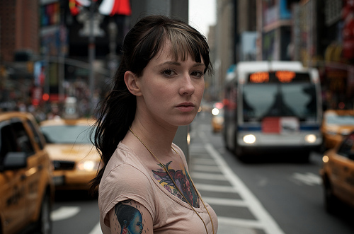 Tattooed girl on the streets of Times Square